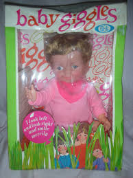 Another favorite doll, Giggles.  Poor thing who kept my sisters awake at night; when you moved her arm she would giggle, a lot!